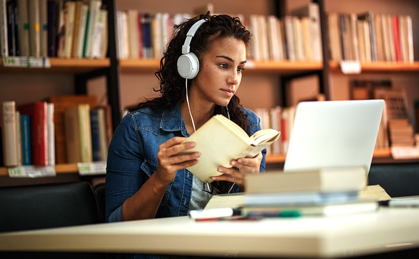 college-student-in-library-with-headphones